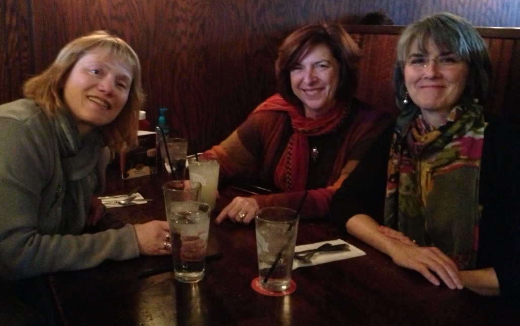 Catherine and friends swapping stories at the Writers' Institute.